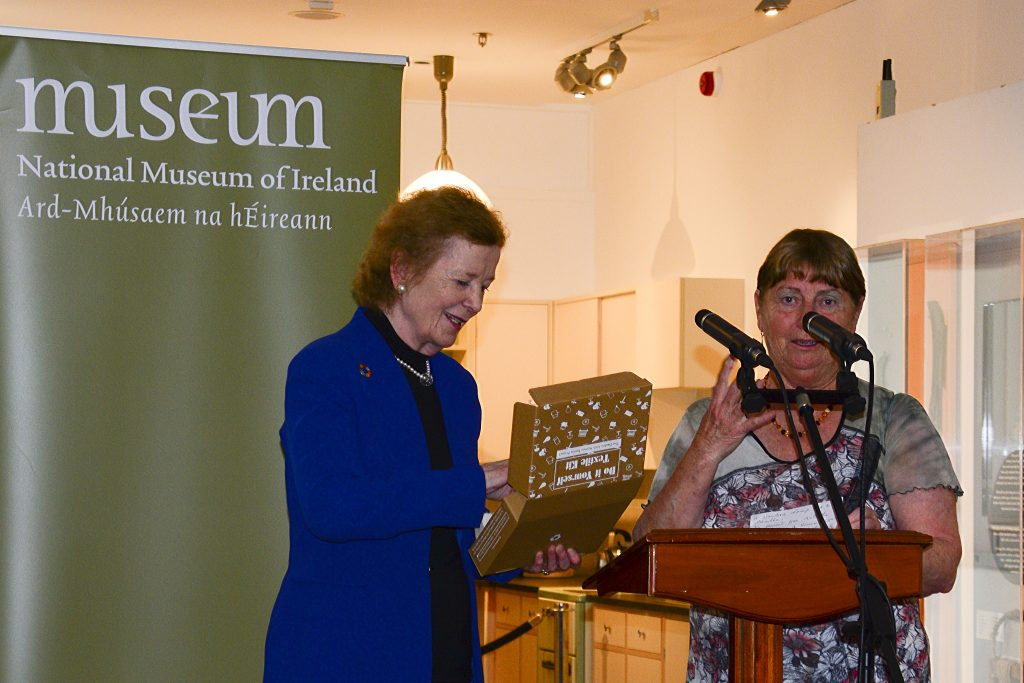 Maura McGuinness presenting Mary Robinson with a textile craft kit